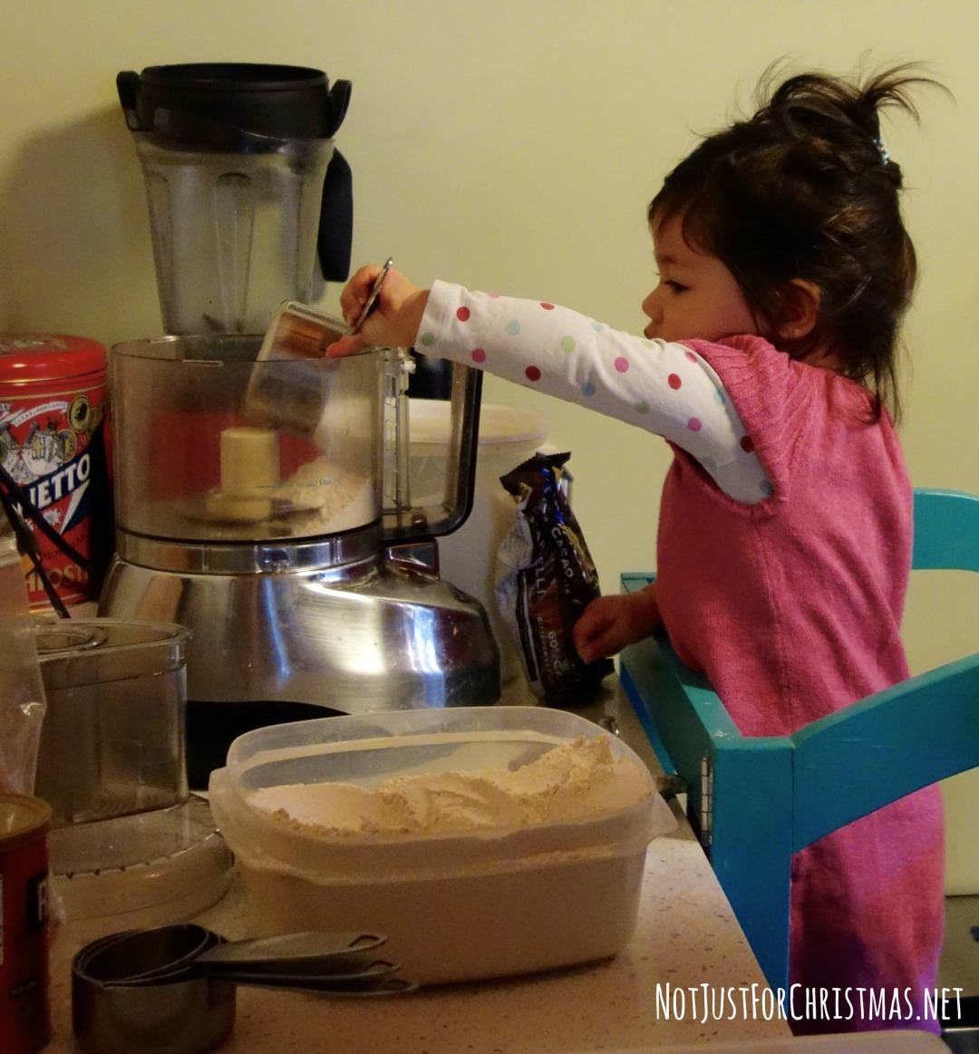 cooking with a toddler scooping flour